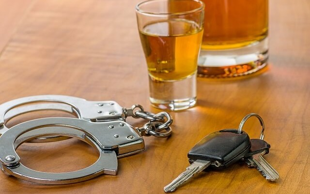 alcohol, car keys, and handcuffs